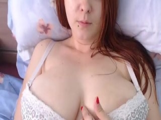 Smoking hot MILF teasing her sexy nipples